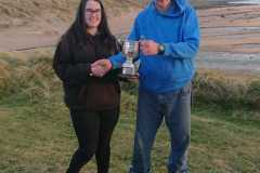 Linda-Manton-receiving-Inisfail-Cup-from-Cathal-McCormack